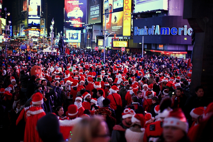 Do you see me? I'm the 8th Santa from the left near the center standing next to the guy in the red.